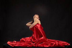 Girl draped in red